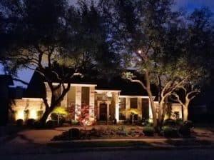 Nice brick home with well lit landscaping