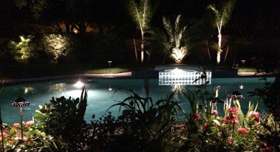 Lighting around a pool at night beautifies the scene