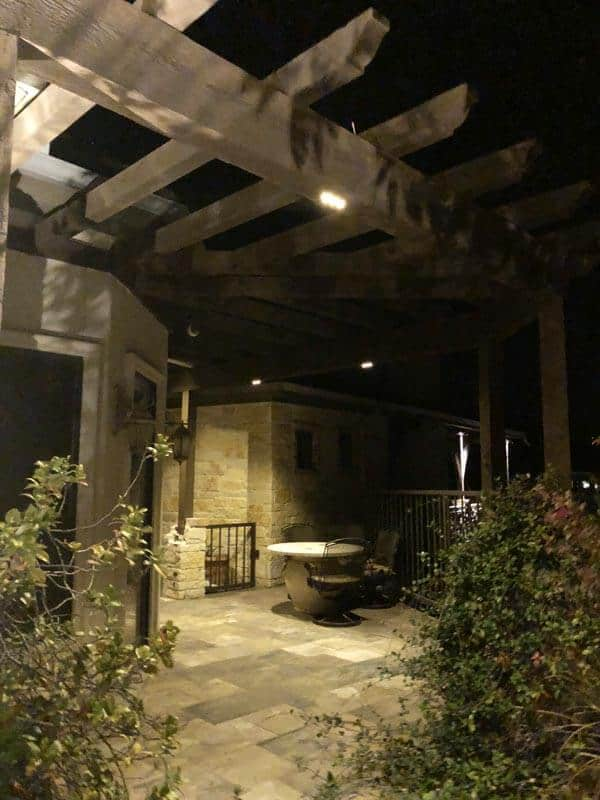 Outdoor Kitchen and Patio Lighting with a table.